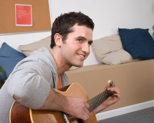 Young man playing guitar.png